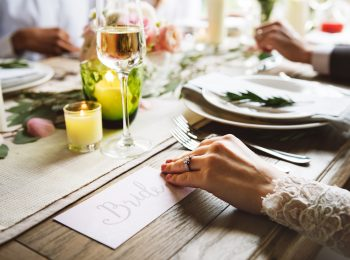 Bride showing Enagaement Ring on Left Hand on Wedding Celebration with Family