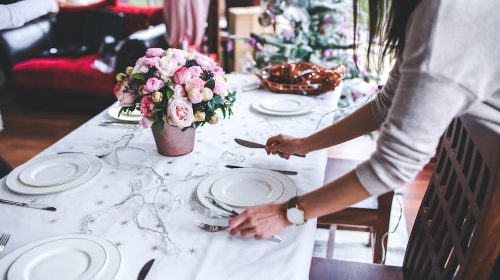 woman organising table for private catering service